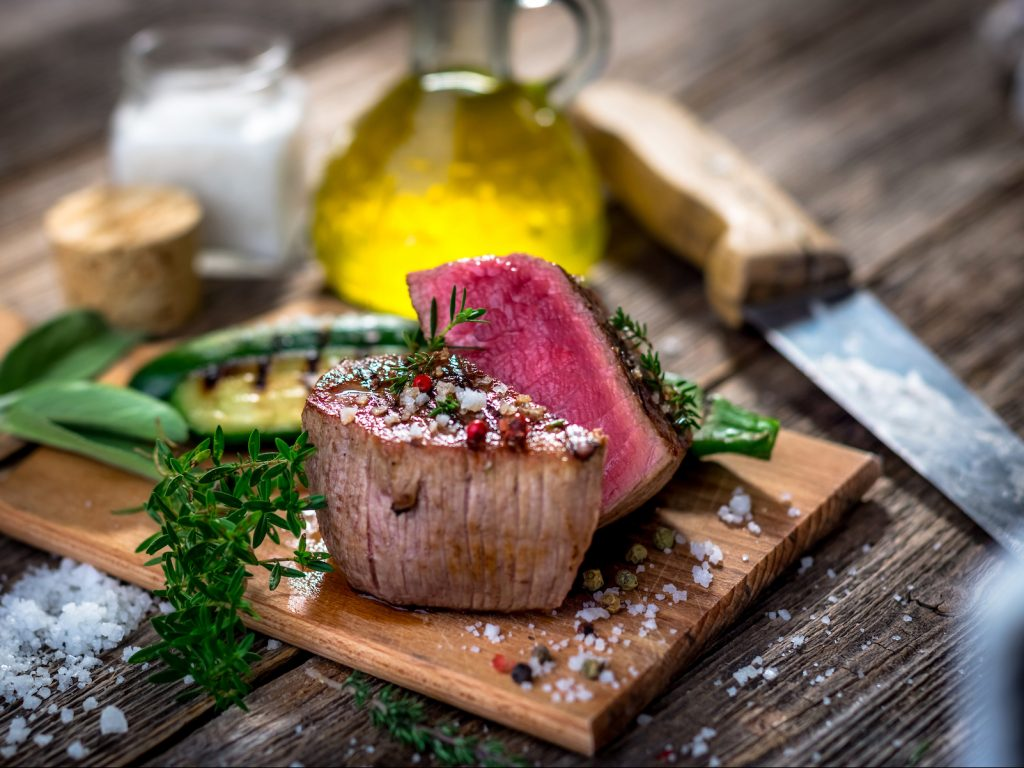 polandshiok.sg Grilled beef steak  on wooden cutting board